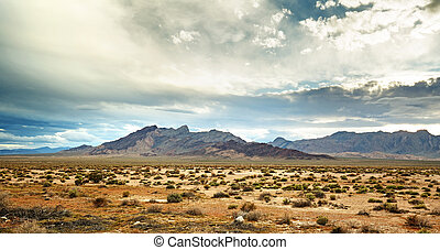 panoramic view of the mojave desert under a cloudy sky
