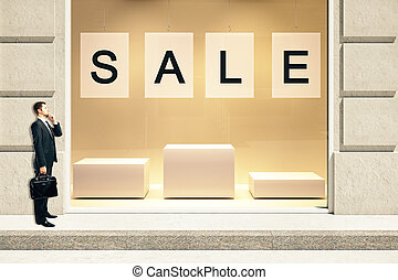Sale concept with businessman - Sale concept with showcase...