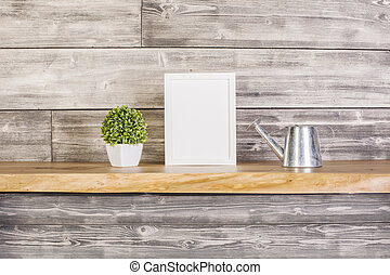 Frame, plant and watering-can - Blank frame, plant and...