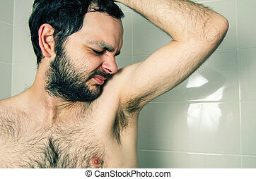 funny man having bad smell from armpit