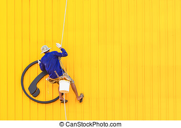 A worker climbing on a wall