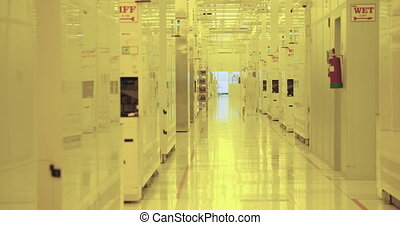semiconductors production facility - Workers in a clean room...