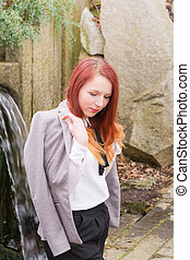 young woman looking down - fashionable young woman looking...