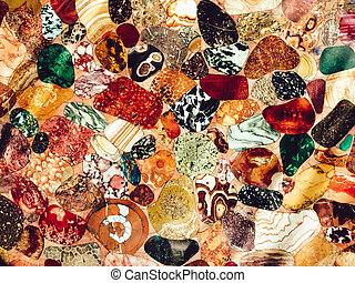 Many colored stones on a table Design photo