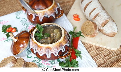 On holiday table pot with meatless soup. Scoop up full spoon...