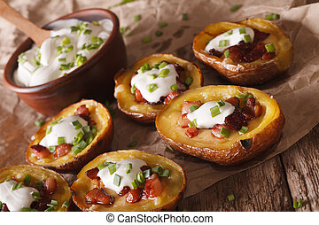 Baked potato skins with cheese, bacon and sour cream...