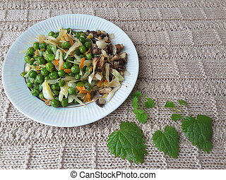 Green peas with vegetables on plate - Green peas with...