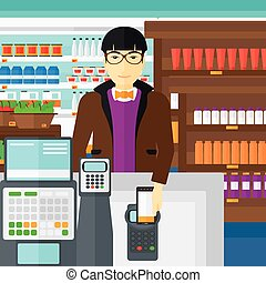 Customer paying with his smartphone using terminal. - An...