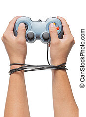 hand holding game controller and tied up with cables...