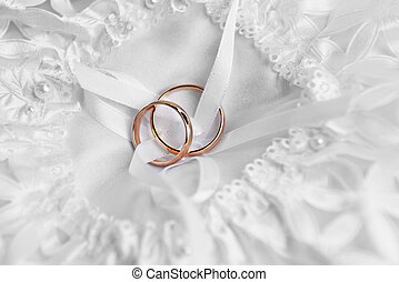rings on bridal pillow - two gold wedding rings on bridal...