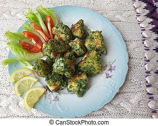 Cauliflower in green nettles tempura, fritters cooking...