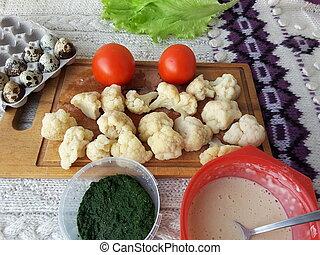 Cooking cauliflower in green nettles tempura, fritters...