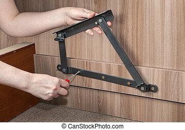 Assembling furniture, hands screwed lift up bed adjustable metal hinge.