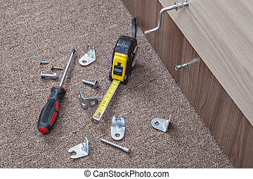 Furniture screws with crosshead screwdriver, tape measure, Hardware and Fasteners.
