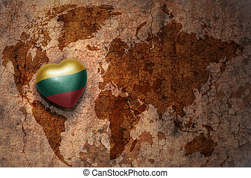 heart with national flag of lithuania on a vintage world map...