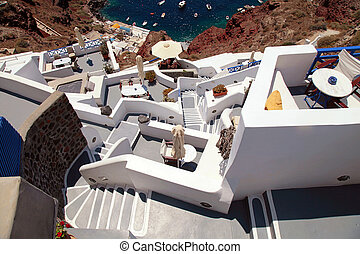 grey and white staircases in volcanic village Oia,...