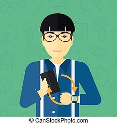 Synchronization of smartphone and smartwatch - An asian man...