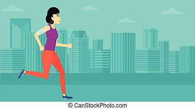 Woman jogging with earphones and smartphone. - An asian...