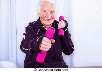 My body is still strong! - Senior woman training, doing...