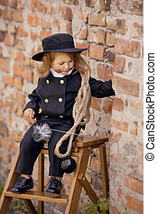 Chimney Sweep Girl - Girl as a chimney sweep against brick...