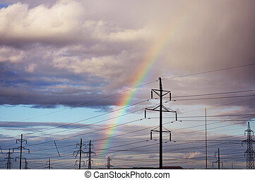 rainbow in the industrial area, electricity poles -...