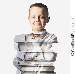 school boy mixed with pile of books - confident school boy...