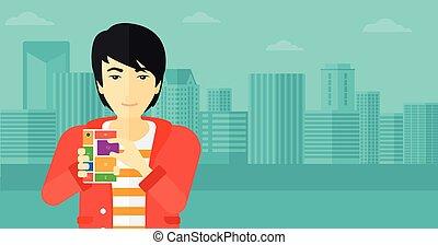 Man with modular phone - An asian man holding modular phone...