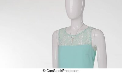 Mannequin wearing light blue dress. Blue dress with lace...