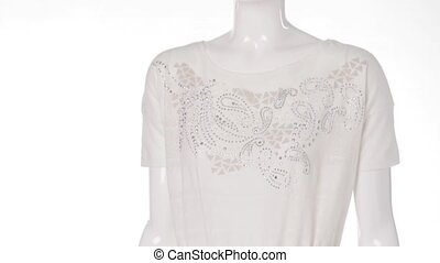 Mannequin wearing white blouse.
