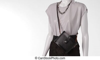 Mannequin wearing blouse with skirt. Silver blouse with...