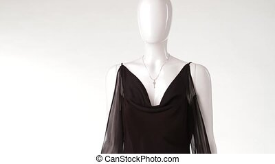 Wind blowing on black blouse. Thin blouse with transparent...