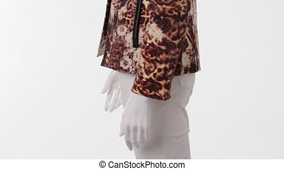 Mannequin in leopard jacket turning. Leopard jacket and...