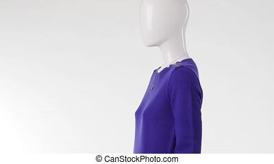 Mannequin in blue sweater turning. Blue sweater with...