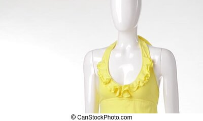 Yellow top on female mannequin Yellow top with denim skirt...