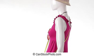 Rotating mannequin in pink top. Mannequin wearing lime...