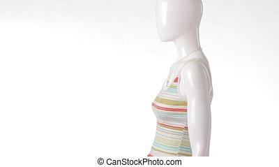 Mannequin in tank top turning. Striped tank top with skirt....