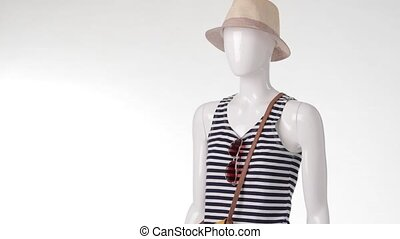 Navy striped top on mannequin. Woman's short denim shorts....