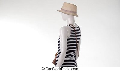 Mannequin in striped top turning Ladys navy striped tank top...
