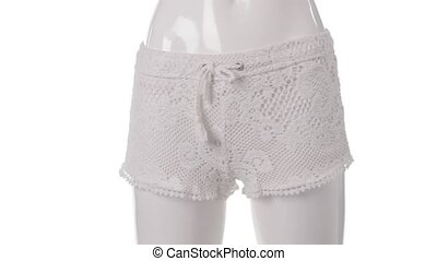 Mannequin in lace shorts turning. Lady's white lace shorts....