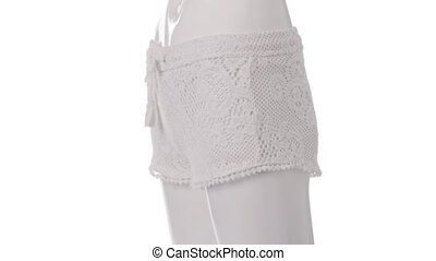 Rotating mannequin in lace shorts. Woman's short lace...
