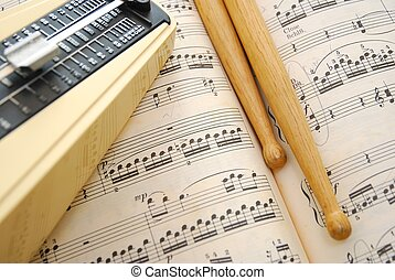 Music score, drum sticks and metronome - Music book, drum...