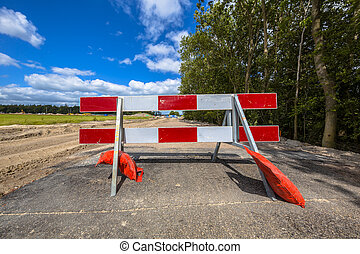 No entry roadblock - Red and white no entry roadblock on a...