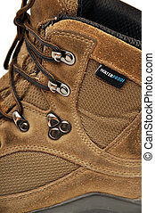 Sturdy hiking boots - A hiking shoes and a white background