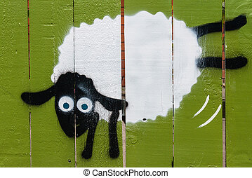 graffiti of jumping sheep on wooden fence