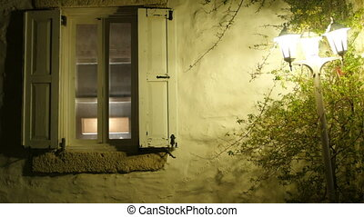 Retro window and street light at night