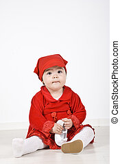 Little red riding hood - Little girl 11 months old sitting...