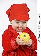 Looks so delicious - Baby girl in red clothes holding an...