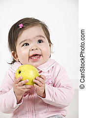 Happy laughing baby with apple - Happy laughing baby girl...