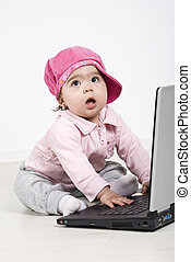 Business baby girl with laptop - Business baby girl sitting...