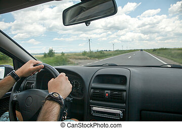 Driving concept – driver hands on wheel and car interior -...